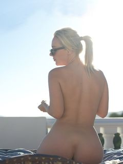 Aston Wilde shows off her hot round butt outdoors